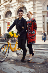 Fashion Editorial, young couple with bicycle at Mailand Street