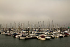 Yacht harbour with many small boats and yachts, peaceful and deserted in autumn,