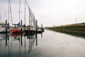 Harbour in Holland, Zeeland, few ships and boats, autumnal weather,