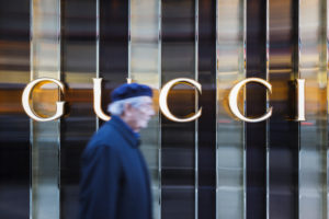 Europe, Germany, Hessia, Frankfurt, older Mister runs past the fashion shop 'Gucci'