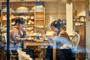 Europe, Germany, Hesse, Frankfurt, Berger street, an Asian couple in a bakery's cafe