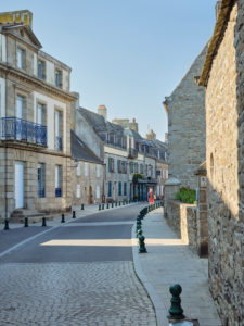 Passer-by on Rue Gambetta in Roscoff in Brittany