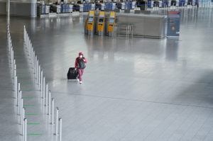A masked traveler crosses Terminal 1 at Frankfurt Airport during the general lockdown in Germany due to the corona pandemic.