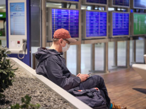 A traveler with a face mask in the waiting area of Terminal 1 at Frankfurt Airport during the general lockdown in Germany due to the corona pandemic.