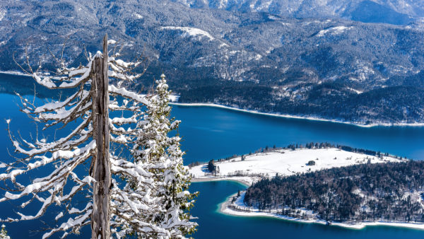 View of the Walchensee with peninsula Zwergern in winter, with Kochel, Bavaria, Germany