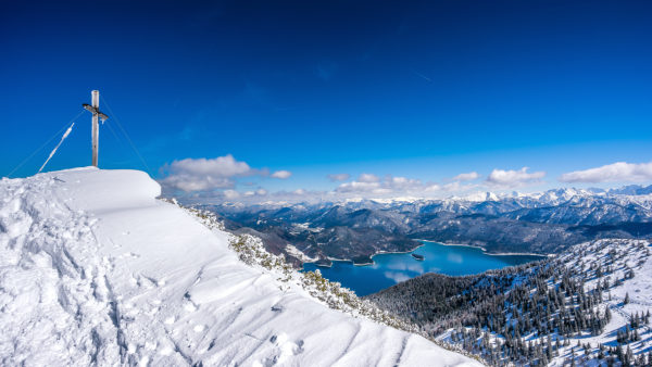 View from the Heimgartengipfel to the Walchensee in winter, with Kochel, Bavaria, Germany