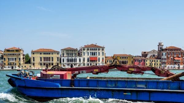 townscape with barge on channel, Venice, Veneto, Italy