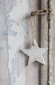 simple little Christmas star hanging on old window handle