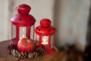 rustic winter still life with apples and lanterns