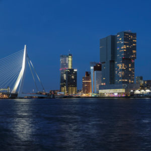 Nieuwe Maas with Erasmus Bridge and skyscrapers at blue hour, Rotterdam, South Holland, Netherlands