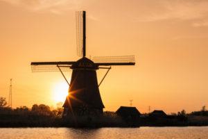 Windmill at sunrise, Kinderdijk, UNESCO World Heritage Site, South Holland, Netherlands