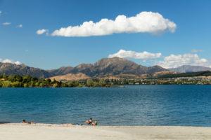 Tourists on the shores of Lake Wanaka, Otago, South Island, New Zealand, Oceania