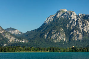 View over Forgensee to Neuschwanstein Castle and Hohenschwangau, Tannheimer Berge, Allgäu, Swabia, Upper Bavaria, Germany
