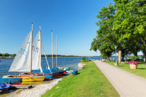 Sailboats on the promenade, Prien am Chiemsee, Upper Bavaria, Germany