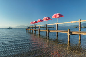 Bathing jetty on Chiemsee with a view of Fraueninsel, Gstadt, Chiemgau, Upper Bavaria, Germany