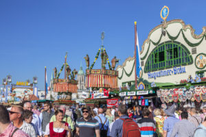 Visitors in front of the Augustiner-Bräu beer tent at the Munich Oktoberfest, Ludwigsvorstadt, Munich, Upper Bavaria, Bavaria, southern Germany, Germany, Europe