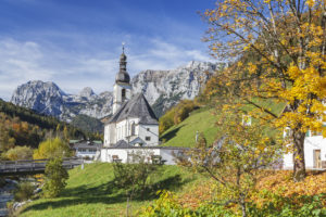 View from the Malerwinkel on Church of St. Sebastian and Fabian, Ramsau, Reiter Alm in the Berchtesgaden Alps in the background, Berchtesgadener Land, Upper Bavaria, Bavaria, southern Germany, Germany, Europe