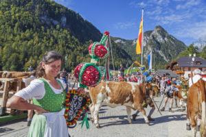Dairymaid on arrival in Schönau, Almabtrieb am Königssee from the Saletalm of the Resch family, Berchtesgadener Land, Upper Bavaria, Bavaria, Southern Germany, Germany, Europe