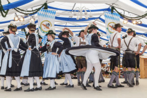 Marquee with traditional men and women in Rosenheim for the Gaufest of Gauverband I, Upper Bavaria, Bavaria, Southern Germany, Germany, Europe