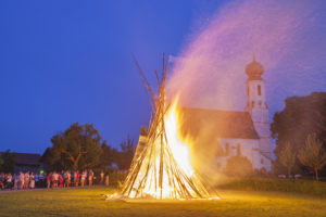 Peter and Paul fire in front of the church in Nussdorf in Chiemgau, Upper Bavaria, Bavaria, southern Germany, Germany, Europe