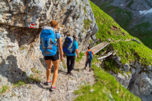 Hike around the Koenigssee, hikers in the Landtal on the way from the Gotzenalm to the Wasseralm, Schönau am Koenigssee, Upper Bavaria, Bavaria, Southern Germany, Germany