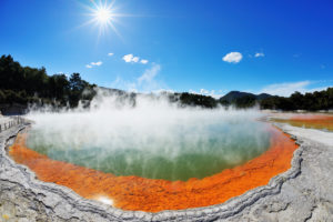 Champagnerpool with sun, Wai-O-Tapu Thermal Wonderland, Bay of Plenty, North Island, New Zealand