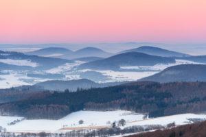 Low mountain landscape at dusk in winter, Milseburg, Danzwiesen, Rhoen Mountain, Hesse, Germany