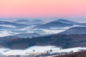 Low mountain landscape at dusk in winter, Milseburg, Danzwiesen, Rhoen Mountain, Hesse, Germany