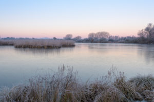 Frozen lake in winter, Reinheimer Teich, Reinheim, Hesse, Germany