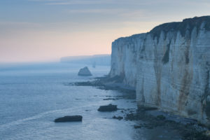 Cliffs with coastline at dawn, Etretat, Seine-Maritime Department, Atlantic Ocean, Normandy, France
