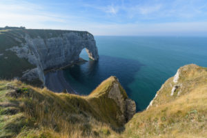 Stone arch on the coast, Etretat, Seine-Maritime Department, Atlantic Ocean, Normandy, France