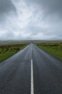 Country road in landscape, Dartmoor, Devon, South West England, England, United Kingdom, Europe