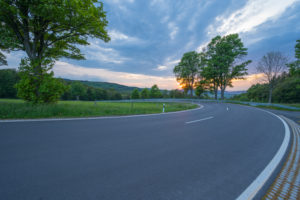 Hairpin curve, country road, sunset, spring, Reulbach, Ehrenberg, Rhön, Hesse, Germany