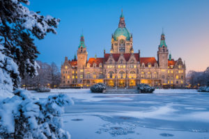 City Hall of Hannover, Germany in winter with snow and frozen lake