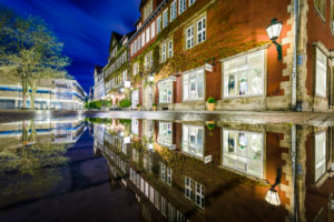 Reflection in a rain puddle in the old city of Hannover, Germany