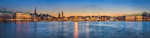 Germany, Skyline of Hamburg along Alster lake with Christmas decorations