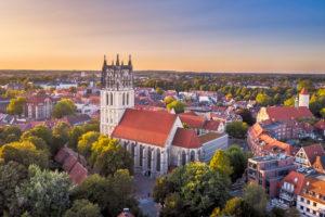 Aerial sunset view of the Überwasserkirche church in Münster, Germany