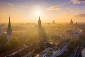 Old town of Hannover, Germany on a foggy autumn morning with Kreuzkirche and Marktkirche churches and Rathaus (Town Hall) in the background