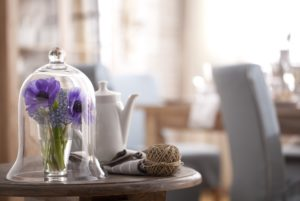Cloche, flowers, teapot, ball of wool,