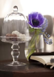 Glass, chocolates, flowers, book,