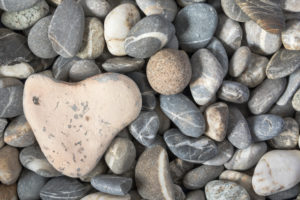 Heart-shaped stone on pebble beach