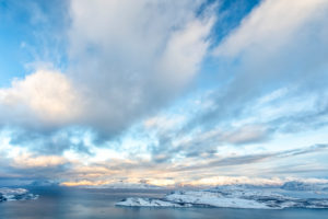 Winter view of the Kvaenangen Fjord with snow-capped mountains