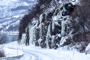 Frozen water in the shape of long icicles on the E6 in Norway in the province of Troms