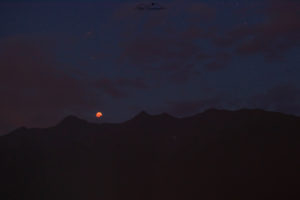 Lunar Eclipse above mountains on July 27, 2018, Tyrol, Austria