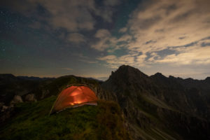 Camping in the mountains below starry sky, Stubai Alps, Tyrol, Austria