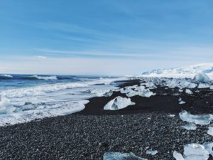 bizarre ice formations were touched on the black sand beach of Diamond Beach, Iceland