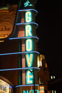 "USA, California, Los Angeles, neon sign of ""The Grove"" shopping center"