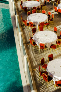 USA, Nevada, Las Vegas, round tables with red velvet chairs