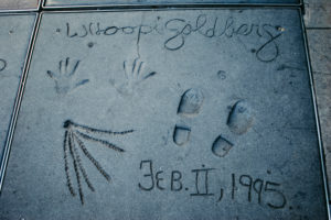 USA, California, Los Angeles, Hollywood Boulevard, world-famous hand and shoe prints by Whoopie Goldberg (including a strand of her dreadlocks) at the Grauman's Chinese Theater