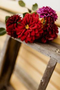 Dahlia bouquet, wooden ladder, garden bench